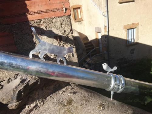 décoration en zinc sur un tuyaux de descente zinc